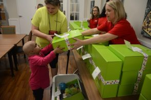 An eager recipient of the Cheeriodicals box. (Karim Shamshi-Basha/Alabama NewsCeter)