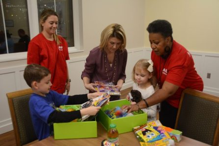 Contents of Cheeriodicals boxes are opened at Ronald McDonald House. (Karim Shamshi-Basha/Alabama NewsCenter)