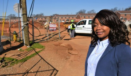 Samford University junior Adriene Gadsden near the Loveman Village public housing community worksite in Birmingham. Gadsden is an apprentice with Hollyhand Development, which is partnering with the Housing Authority Birmingham District in redeveloping Loveman Village, where Gadsden lives. (Solomon Crenshaw Jr./Alabama NewsCenter)
