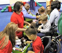 APSO volunteers at Hand in Hand with young recipients of Cheeriodicals. (Photos courtesy of Hand in Hand)