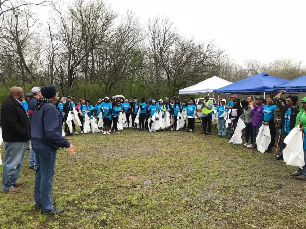 Volunteers gather to begin removing debris and litter from Valley Creek during an annual cleanup. (Michael Sznajderman/Alabama NewsCenter)
