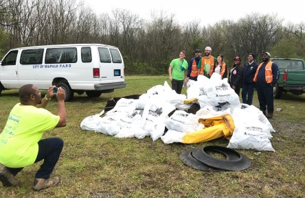Renew Our Rivers volunteers pose for a photo with some of the trash they collected from Valley Creek on Saturday. (Michael Sznajderman/Alabama NewsCenter)