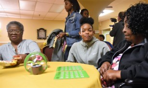 Ramsay's Madison Clay plays bingo with South Health and Rehabilitation patients. (Solomon Crenshaw Jr. / Alabama NewsCenter)