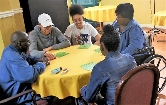 The Ramsay High School girls basketball team plays bing with residents of neighboring South Health and Rehabilitation. (Solomon Crenshaw Jr. / Alabama NewsCenter)