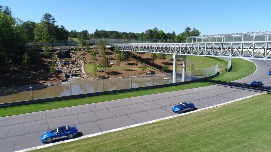 The new waterfall and pedestrian bridges add to the excitement of the track. (Barber Motorsports Park and Museum)
