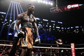 Deontay Wilder (gold shorts) successfully defended his WBC title by defeating Luis Ortiz with a TKO. (Amanda Westcott/Showtime)
