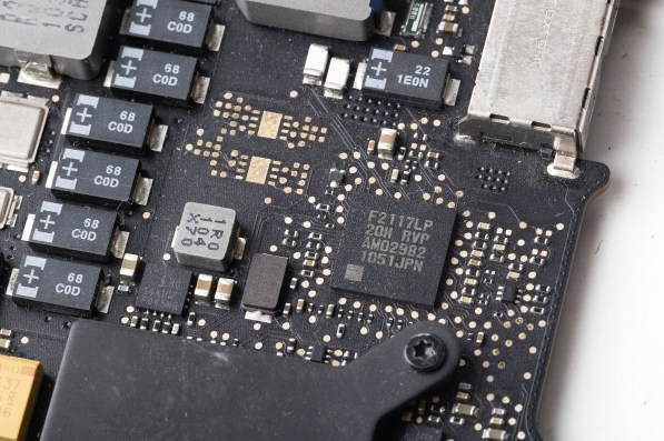An Intel Corp. System Management Controller (SMC) chip, center right, from an Apple Inc. MacBook Pro laptop computer. (Brent Lewin/Bloomberg)