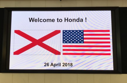 Honda greets the Alabama team with the Alabama and U.S. flags. (contributed)