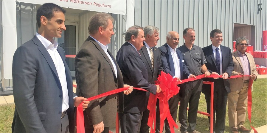 Officials mark the grand opening of the SMP auto parts plant in Tuscaloosa, which employs 320 people and eventually may employ 1,000. (contributed)