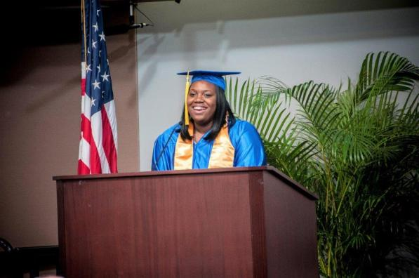 Generation IT graduate Kenisha Yarbrough speaks at the commencement. (Billy Brown / Alabama NewsCenter)