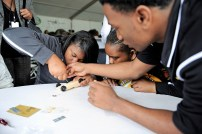 A pinewood derby race with cars designed by students is part of the Alabama Power education event at Barber Motorsports Park. (Phil Free / Alabama NewsCenter)