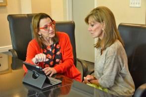 Violins of Hope Birmingham Executive Director Sallie Downs, left, talks with co-chair Gail Bayer. (Karim Shamsi-Basha/Alabama NewsCenter)