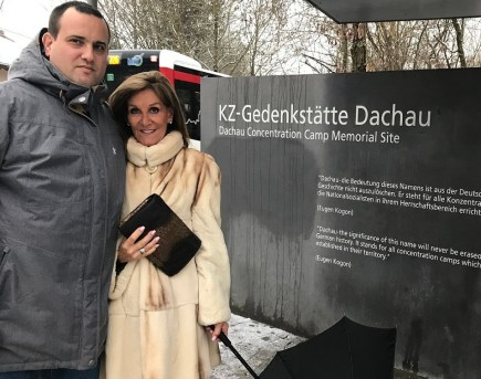 Avshi Weinstein stands with Gail Bayer at the former concentration camp at Dachau, where musicians played the Violins of Hope in a performance. (Courtesy Jeffrey and Gail Bayer)