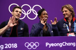 Morgan Ciprès and Vanessa James with their coach John Zimmerman IV at the 2018 Winter Olympics in Pyeongchang, South Korea. (Jamie Squire/Getty Images)