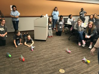 The students race cars they made from water bottles and balloons, an exercise that taught them about aerodynamics, propulsion and mechanical engineering. (contributed)