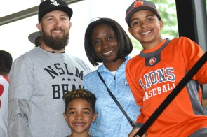 The Davis family -- father Jeremy, mother Tiffany, 11-year-old Jackson and 7-year-old Jamison -- attended the festivities Sunday on Jackie Robinson Day at Negro Southern League Museum. They live in Huntsville. (Solomon Crenshaw Jr./Alabama NewsCenter)