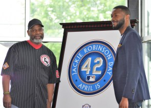 Birmingham Mayor Randall Woodfin, right, and John Chaney pose after unveiling a comemorative display for Jackie Robinson Day at the Negro Southern League Museum on Sunday. (Solomon Crenshaw Jr./Alabama NewsCenter)