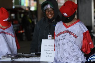 """Barons staffer Deborah Wilson stands at the kiosk where fans can bid on the Barons jersey with text from MLK's """"Letter From Birmingham Jail."""" (Solomon Crenshaw Jr./Alabama NewsCenter)"""