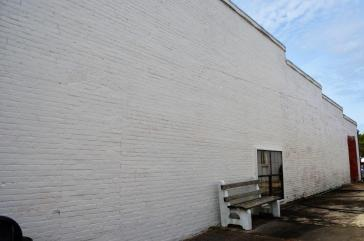 "This wall will soon contain Monroeville Main Street's first mural honoring Truman Capote's ""A Christmas Memory."" (Michael Tomberlin / Alabama NewsCenter)"