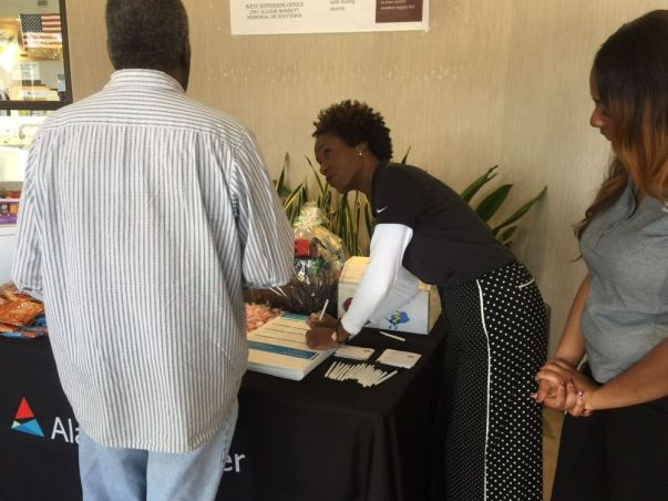 Alabama Power employees help customers sign up for a free emergency preparation kit giveaway. (Keisa Sharpe/Alabama NewsCenter)
