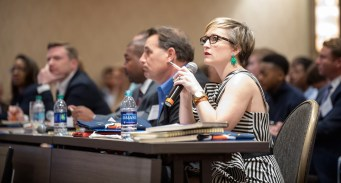 The judges listen to a pitch during Auburn University's annual Tiger Cage student business competition. (Auburn University)