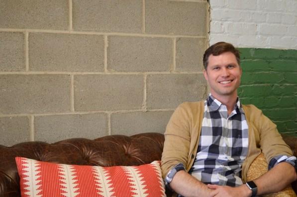 Designer Bradley Dean enjoys the art life at Lowe Mill. (Anne Kristoff/Alabama NewsCenter)
