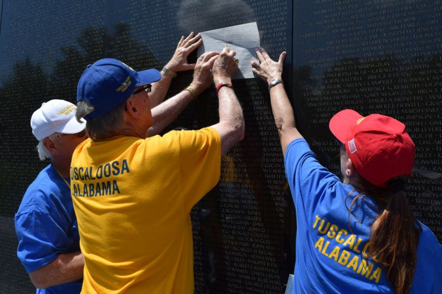 Many of the Vietnam Veterans sought the names of their fallen comrades, tracing the outline of their names onto paper provided by U.S. Park Services. (Donna Cope/Alabama NewsCenter)