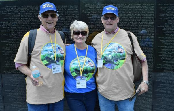 Guardian Elizabeth Stone (center) enjoyed helping two Vietnam veterans she assisted during the Honor Flight. (Donna Cope/Alabama Power)