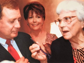 Harper Lee selects a pen from James E. Rotch and his wife, Darlene. (Courtesy of James E. Rotch)