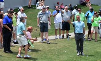 Taylor Hicks warns patrons to stand clear of his wayward next shot. (Solomon Crenshaw/Alabama NewsCenter)