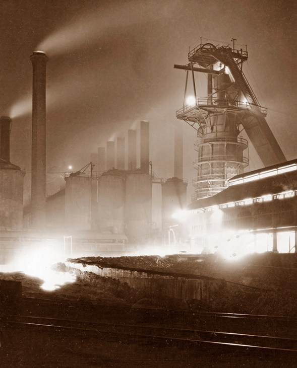 A night image of Sloss Blast Furnace in operation in the 1920s. (From Encyclopedia of Alabama, courtesy of Birmingham Public Library Archives)