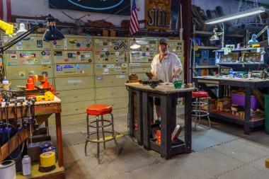 Roger Fritz works on a guitar in his Fairhope studio. (Mark Sandlin/Alabama NewsCenter)