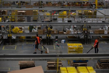 Employees pull carts containing online orders at the Amazon.com Inc. fulfillment center in Robbinsville, New Jersey. (Bess Adler/Bloomberg)