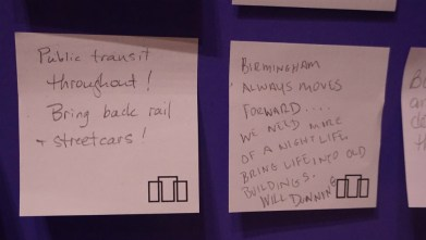 """""""Magic City Realism: Richard Coe's Birmingham."""" Exhibit visitors have left their thoughts on paper. (Erin Harney/Alabama NewsCenter)"""