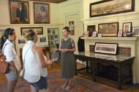 Sarah Powell talks with visitors to the F. Scott and Zelda Fitzgerald Museum in Montgomery, the world's only museum devoted to the great American literary couple. (Karim Shamsi-Basha/Alabama NewsCenter)