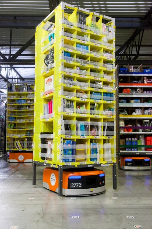 An automated transport robot moves goods in a storage unit at the Amazon.com Inc. fulfillment center. (Amazon)