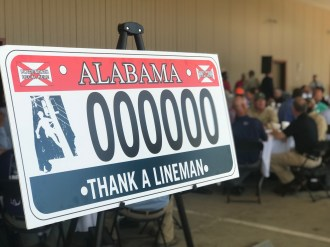 The design of a new license plate honoring linemen is displayed at a ceremony marking Alabama Lineman Appreciation Day. (Alabama NewsCenter)