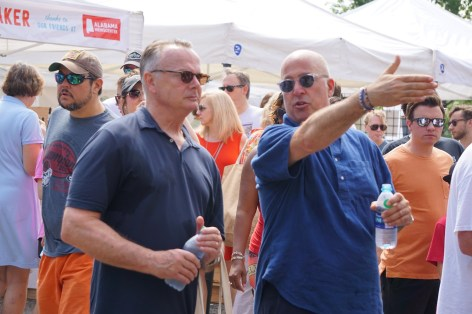 Frank Stitt and Andrew Zimmern navigate the busy Pepper Place market on Saturday. (Erin Harney/Alabama NewsCenter)