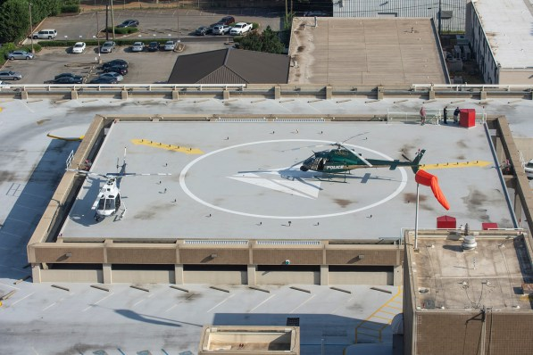"Helicopters use the roof of Alabama Power's parking garage in downtown Birmingham during filming of the movie ""Live!"" on Friday. (Phil Free/Alabama NewsCenter)"