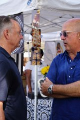 Highlands' Frank Stitt talks with food television star Andrew Zimmern at Birmingham's Pepper Place Market. Their visit was filmed for use in one of Zimmern's television shows. (Erin Harney/Alabama NewsCenter)