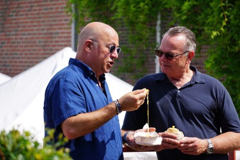 Andrew Zimmern and Frank Stitt sample the food available from vendors at Pepper Place. Zimmern says he considers Birmingham's food scene the hottest of any small city in the country. (Erin Harney/Alabama NewsCenter)