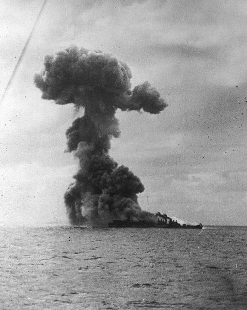 Heavy explosion aft on USS Princeton (CVL-23), with USS Birmingham (CL-62) alongside, Oct. 24, 1944. (U.S. Naval Historical Center National Archives)