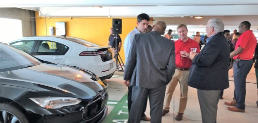 Visitors and officials chat at the opening of Birmingham-Shuttlesworth Airport's electric-vehicle charging stations. (Michael Sznajderman/Alabama NewsCenter)