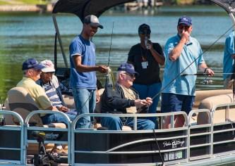Veteran James Traywick (center, seated) fishes on Lake Logan Martin. (Bernard Troncale/Shorelines)