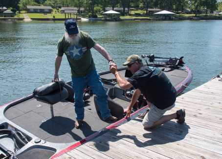 Army veteran Terry Yenour gets help from Curtis Coleman after a day on Lake Logan Martin. (Bernard Troncale/Shorelines)