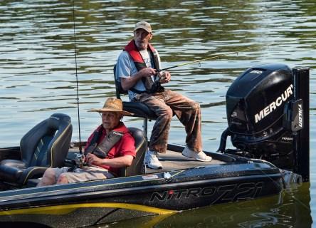 Vets Ed Kopp (right) and John Scully fish during a veterans fishing trip. (Bernard Troncale/Shorelines)