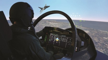 A pilot trains in Leonardo's T-100 simulator. (Leonardo)