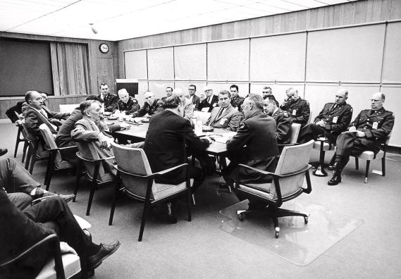 Negotiations between the Army Ballistic Missile Agency (ABMA) and the National Aeronautics and Space Administration (NASA) on Aug. 11, 1959. Seated at the table with his back to the camera is Dr. T. Keith Glernan, NASA administrator. At the head of the table is Maj. Gen. John Barclay, commander of ABMA, and at the right side of the table are Col. John G. Zierdt of ABMA and Dr. Wernher von Braun. (NASA)