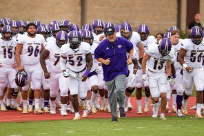 Coach Chris Willis takes the field with his UNA Lions. (University of North Alabama Athletics)