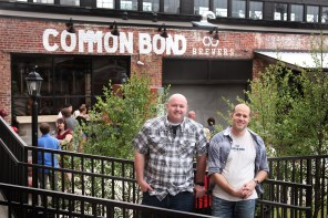 Tim Doles and Andrew McNally enoy the grand opening of their business, Common Bond Brewers, in April. (contributed)